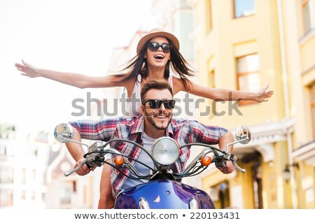 Couple riding scooter together Stock photo © IS2