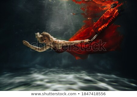 Diving underwater on suitcase Stock photo © bluering