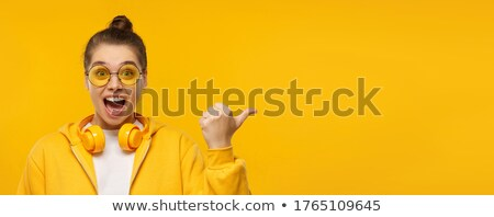 Portrait of a happy girl wearing hoodie Stock photo © deandrobot