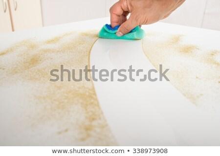 Férfi gondnok takarítás konyhapult középső rész koszos Stock fotó © AndreyPopov