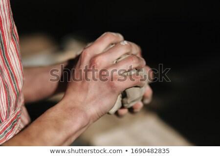 Man kneading clay Stock photo © pressmaster