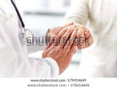 close up of doctor holding senior patient hand stock photo © dolgachov