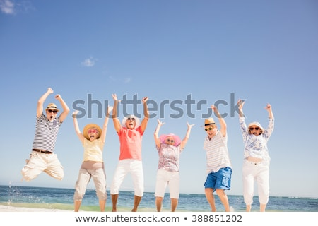 portrait of happy senior caucasian woman standing on the beach stock photo © wavebreak_media