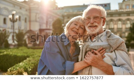 Portrait of active senior Caucasian couple embracing each other in the park Stock photo © wavebreak_media