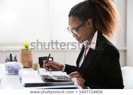 Mujer de negocios impuesto escritorio oficina negocios ordenador Foto stock © AndreyPopov