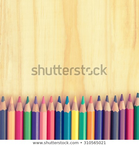 Colored pencils on a wooden board Stock photo © galitskaya