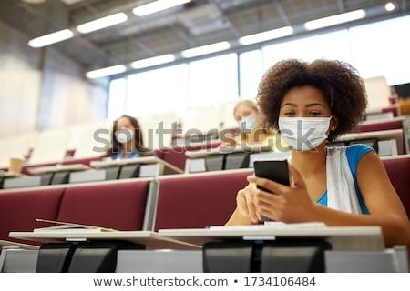 Afryki student dziewczyna smartphone wykład edukacji Zdjęcia stock © dolgachov