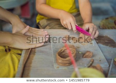 mother and son doing ceramic pot in pottery workshop Stock photo © galitskaya