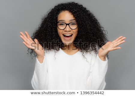 Stock photo: Sincere emotions and feelings concept. Optimistic lovely young female spreads hands, laughs happily