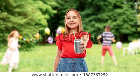 smiling girl with can drink at birthday party Stock photo © dolgachov