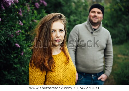 Beautiful couple in love is hugging near a lilac bush. lifestyle photo Stock photo © ruslanshramko