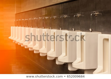 row of white porcelain urinals stock photo © stoonn