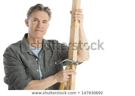 Man holding hammer and planks of wood Stock photo © photography33