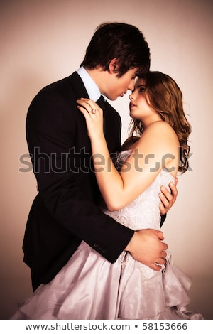couple in evening wear embrace stock photo © rtimages