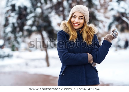 Portrait of young pretty woman in winter park  stock photo © HASLOO