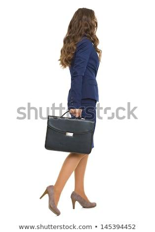 Iş kadını yürüyüş durum bilgisayar omuz çalışmak Stok fotoğraf © varlyte