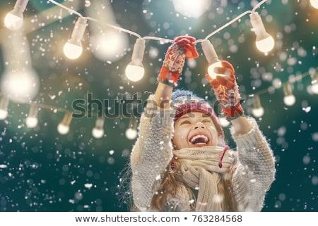 fille · Noël · lumière · guirlande · portrait · jeunes - photo stock © zastavkin