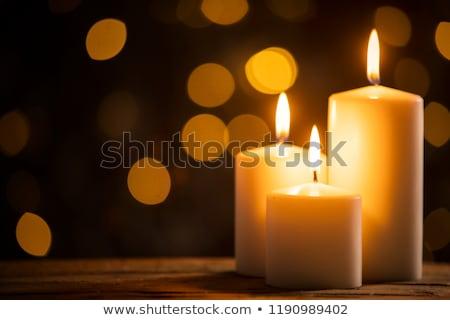 merry christmas with burning candles stock photo © kbfmedia