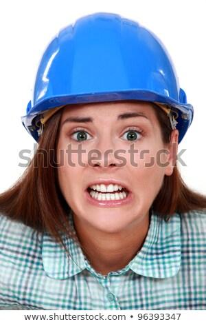 A terror-stricken tradeswoman Stock photo © photography33