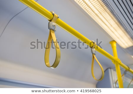 handles for standing passenger inside a train stock photo © kawing921