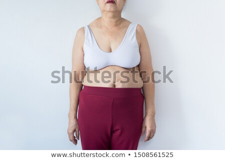 Woman with hands around belly button Stock photo © ruigsantos