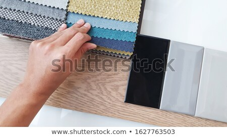 Stock photo: Man with flooring options
