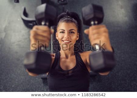 nő · emel · súlyzók · tornaterem · mosoly · narancs - stock fotó © photography33