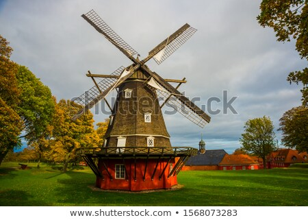 windmills inside summer landscape stock photo © benchart