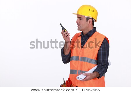 Labourer speaking into a walkie-talkie Stock photo © photography33