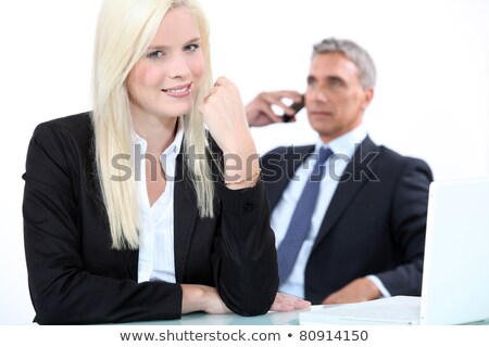 a blonde woman and a mature man well dressed, probably business men Stock photo © photography33