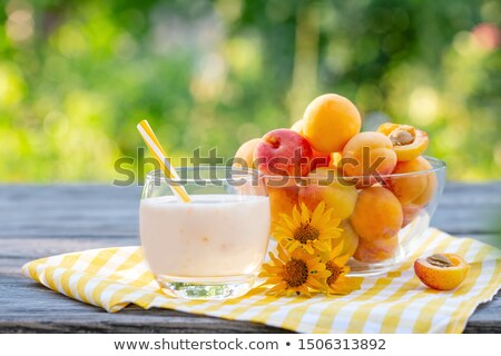 deliscious fresh currant yoghurt shake dessert on table stock photo © juniart