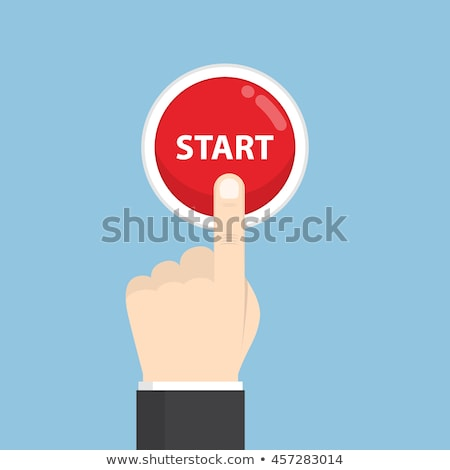 Hand pressing a start button. stock photo © fantazista