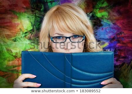 blonde business woman reads the classifier Stock photo © carlodapino