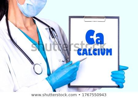 Cálcio pílulas metal colher Foto stock © elenaphoto