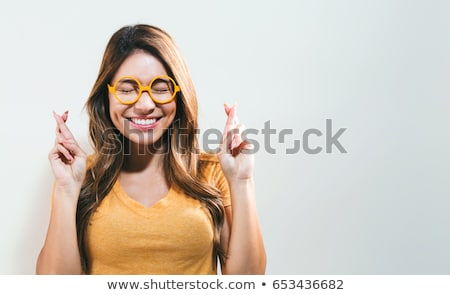 young woman crossing her fingers stock photo © williv