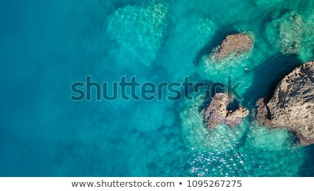 Caribbean blue turquoise sea water color from boat view stock photo © lunamarina