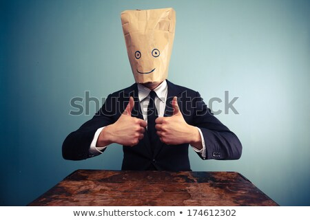 Businessman with paper bag in head stock photo © lunamarina