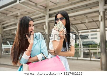 Geloso donna guardando shopping bag felice amico Foto d'archivio © Rob_Stark
