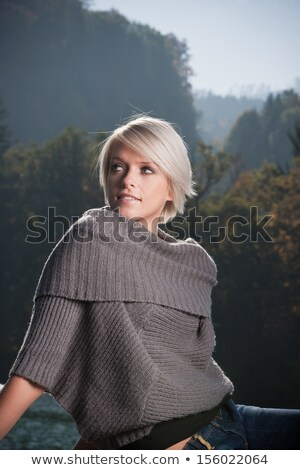 Beautiful blond woman with a wistful look Stock photo © dash