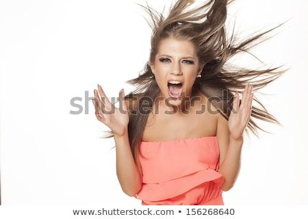 Сток-фото: �расивая · молодая · женщина · с · волосами · на · ветру · кричала · от · ярости