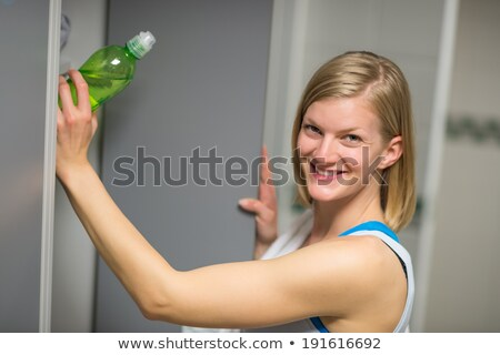 woman putting bottle in locker at healthclub stock photo © candyboxphoto