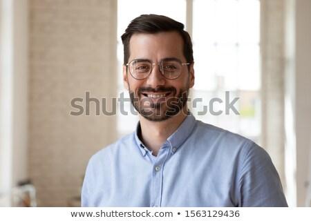 üzletember izolált stúdió mosolyog Stock fotó © dgilder