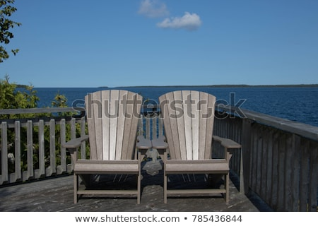Chairs on a pier, Georgian Bay, Tobermory, Ontario, Canada Stock photo © bmonteny