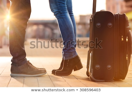 Lovely Couple Kissing While in Tiptoe Stock photo © stryjek