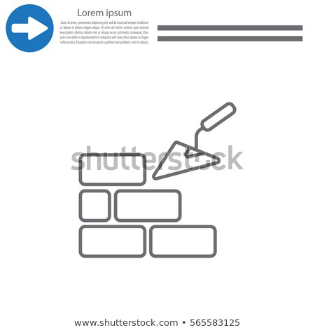 Building with trowel and bricks Stock photo © ivonnewierink