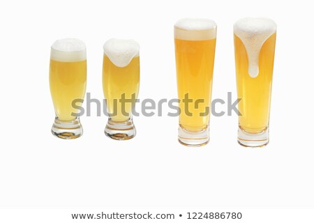 Empty transparent glasses and full of beer with white froth Stock photo © LoopAll