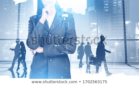 pensive businesswoman stock photo © diego_cervo