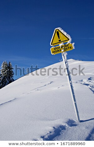 Off-piste slope and warning sign of avalanches Stock photo © BSANI