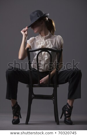 Cabaret Dancer sitting on a Chair Stock photo © ankarb