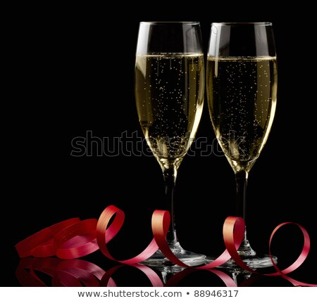 Stock photo: Glasses of champagne with red ribbon
